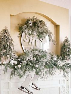 Create a winter wonderland on your Christmas mantel with fresh cedar branches along with white and silver embellishments.