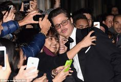 Making time for the fans: Pitt posed for selfies on the red carpet with eager fans...