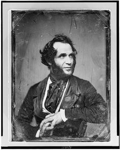 Unidentified man, about 40 years of age, half-length portrait, slightly to left, head three-quarters to right, arm over back of chair, hands clasped in front, with heavy side whiskers; c. 1844-1860