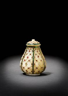 An impressive Indian gem-set jade covered Vessel     of pear-shape, the jade carved and inlaid with gold, in turn set with diamonds, rubies and emeralds. 10.5 cm. high
