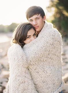 engagement photos with blanket. He's a little too 'little' boyish looking for me, but still a cute picture.