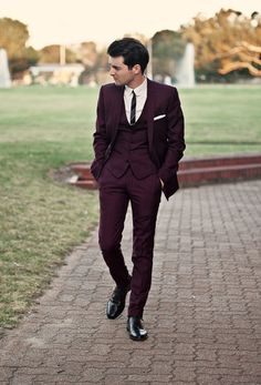 Forget the black, navy, and gray suits at the shop. Fall is the ideal season to bring out a more interesting and vibrant hue: a maroon groom's suit. Whether you decide to go all in with a wedding suit or choose to accessorize with maroon details, you can't go wrong with this hot color.