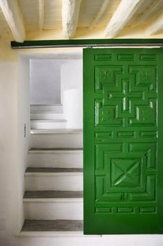 Love this sliding door, and the high gloss green color, I also like the fact that there's a door at the bottom of the stairs, unexpected. // Chris, this would solve our attic stair dilemma.