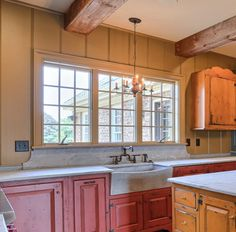 Colorful distressed cabinets with grey soapstone counter