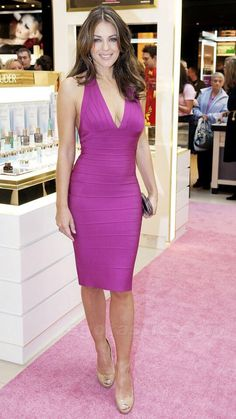 Elizabeth Hurley showing off her magnificent physique in a purple skin tight dress.