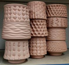 ...cups and bowls and textures to be glazed at HCC. I enjoy these because I really don't care how they turn out...they're demos explorations and investigations. Some will be nice and some will not. I like it like that. by lyonclay