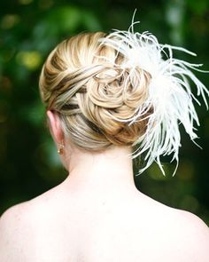 pretty hairstyle and awesome fascinator
