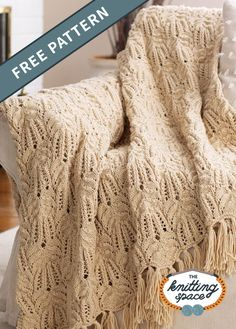 Relax to the outstanding comfort and coziness of the Lace-and-Cable Knitted Afghan. It features a stunning cable and lace combination that will absolutely look gorgeous on your couch or bed. And it's the perfect handmade housewarming gift, too.   Discover over 5,500 free knitting patterns at theknittingspace.com #knitpatternsfree #DIY #howtoknitblankets All Free Knitting, Winter Knitting Patterns, Dishcloth Knitting Patterns, Cable Knitting, Knitted Afghans, Knit Patterns, Knitting Ideas, Summer Knitting Projects, Relax