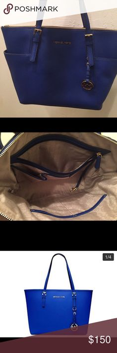 Michael Kors purse Michale Kors: Large Jet set, top zip tote in royal blue   Authentic  Used: only wore once  Paid almost $300 but asking for $150 Michael Kors Bags Totes