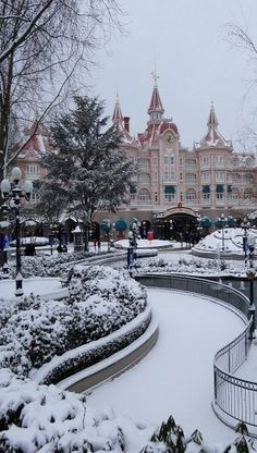 Disneyland Paris Under Snow, France. I went with my college when it snowed. So beautiful!