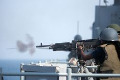 GULF OF ADEN (Aug 16, 2013) Boatswain's Mate 3rd Class Theresa Bell fires a M240B machine gun during a live-fire exercise aboard the amphibious dock landing ship USS Carter Hall (LSD 50). Carter Hall is a part of the Kearsarge Amphibious Ready Group and, with the embarked 26th MEU, is deployed in support of maritime security ops and theater security cooperation efforts in the U.S. 5th Fleet area of responsibility. (U.S. Navy photo by Mass Communication Specialist 3rd Class Sabrina…