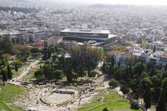 The view of the Acropolis Museum and an ancient Greek theater from the Acropolis hill. Picture and words by Slow Travel, Us Travel, Ancient Greek Theatre, Acropolis, Luxury Travel, Travel Photos, Paris Skyline, Theater, Museum