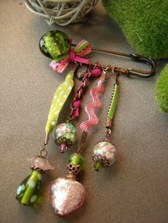 Brooch.  Like the idea of the ribbon & rick rack.