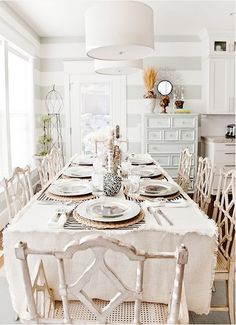 I love this almost shabby chic farm table, white on white is always a favorite for me.