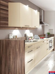 Perfekt Schicke Küchenzeile: Die Einbauküche Norina 1351 Magnolia überzeugt Mit  Cremefarbenen Fronten Und Einer Arbeitsplatte Aus