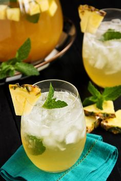 Pineapple Mint Julep Sangria from afarmgirlsdabbles.com - A fun twist on the traditional mint julep beverage served at the Kentucky Derby each spring, and perfectly refreshing all summer long - pineapple juice, fresh mint, crisp white wine, and a splash of Bourbon make a refreshing cocktail!