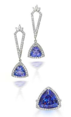 A tanzanite and diamond ring and earring suite  The ring set with a trillion-cut tanzanite, within a round brilliant-cut diamond surround between diamond-set shoulders, mounted in 18k white gold, the earrings each suspending a similar tanzanite and diamond cluster drop, to a pierced kite-shaped diamond-set surmount, mounted in 14k white gold
