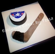 Tri-Cities Americans Hockey stick & Hockey Puck cake by Exclusive Cakes by Tessa