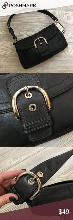 "COACH Black Leather Baguette Soho Handbag!! Excellent ✨AUTHENTICATED✨ Black Leather COACH Soho Baguette Handbag with 3 Buckle setting closure  Approximate Size: 12""x8"" 8"" Drop Handle  Authentication: No M0867-F13105 Good used condition - small light imperfection (discounted price accounts for imperfection) - see last photo to view before purchase. Coach Bags Hobos"