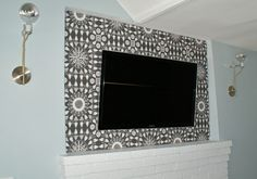 use a fabric panel to hide wall-mounted TV wires (mavenfresh)