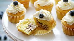 A lemony cupcake stuffed with sweet blueberry cheesecake and topped with a creamy vanilla frosting.