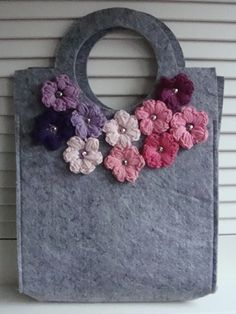 Felt bag with crochet puffy flowers