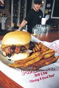 Mississippi Magazine's Best Burger for 2011 from Main St member Mugshots Bar & Grill