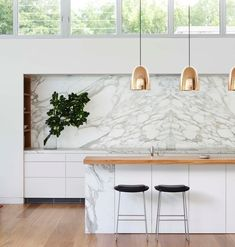 Modern kitchen: marble backsplash, wood countertop and copper pendants for island. Kitchen Inspirations, House Interior, Home Kitchens, Bright Kitchens, Kitchen Marble, Kitchen Design, Kitchen Trends, Kitchen Dining Room, Home Decor