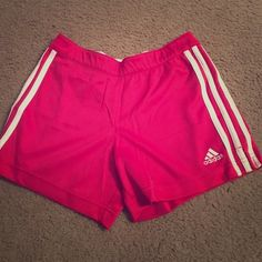 Pink Adidas Running Shorts -Kids M-Adult XS Mesh like running shorts that I purchased in the kids section of sports authority. Should fit an adult XS! In perfect condition no rips, stains or peeling. Adidas Shorts