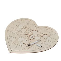 For an alternative to a traditional wedding guest book we love this jigsaw puzzle. The jigsaw puzzle wedding guest book is heart shaped and made from wood. Guests can write their kind words on a puzzle piece and then place the pieces of the puzzle together. The puzzle comes with a card explaining to guests what to do. It reads; Dear family and friends, please help keep this memory by signing a puzzle piece and adding it to the heart. Thank you so much for sharing part of this special day…