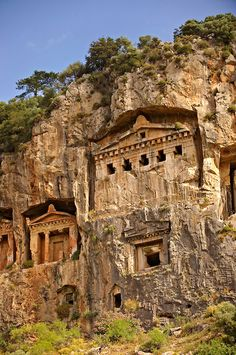 The Hellenistic temple-fronted Tombs of Kaunos, 4th - 2nd cent. BCE, just outside the archaeological site of Kounos on the opposite side of the Calbys river from Dalyan, Turkey.