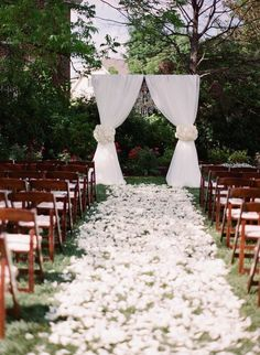Photo: Almond Leaf Studios; gorgeous white outdoor wedding ceremony;