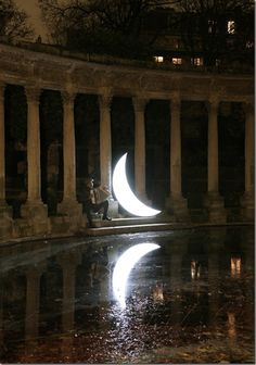 Moon floating romantically on earth ! Captured By Artist leonid tishkov