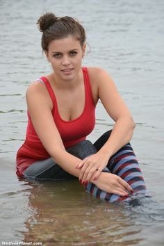 Red vest, leggings and socks in the sea