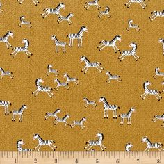 Mini Zebras Gold from @fabricdotcom  From Timeless Treasures, this cotton print is perfect for quilting, apparel and home décor accents.  Colors include brown, tan, pink, black and white.