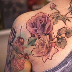 Gorgeous rose shoulder tattoo - very delicate and almost vintage