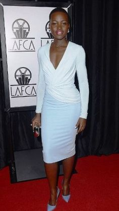 Lupita Nyongo in white cocktail dress.jpg