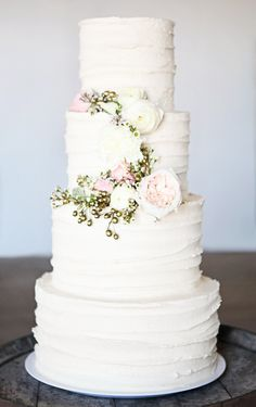 Wedding cake, purple flowers instead of pink.