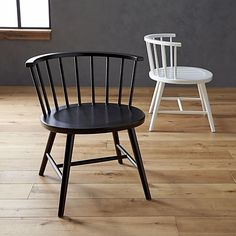2-4 of the black low back, black chairs.    Riviera Black Low Windsor Side Chair in All Paola Navone | Crate and Barrel