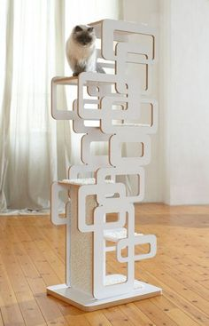 This is a fine piece of cat furniture! What a cool cat tree!