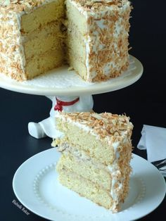 Coconut almond cream cake is a coconut lover's dream cake, and the perfect Easter dessert recipe. Coconut cake is filled with almond cream filling, then topped with fluffy coconut cream cheese frosting!   BlahnikBaker.com
