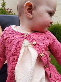 An Bronntanas An Bronntanas is a cute and pretty baby cardigan that's versatile enough for a girl or a boy. The simple lace design on the yoke adds interest. MATERIALS Yarn: Double knit 250 - 490 metres/273 - 534 yards Shown