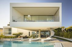 Dorfler House, located in Meia Praia, Lagos is a contemporary two-story residence designed in 2020 by Vitor Vilhena Architects.