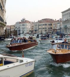 Chaotic scenes: The nuptials took place at sunset on Saturday, with crowds lining Venice's Grand Canal to cheer on George and his A-list guests, who travelled in style to the Aman hotel in a flotilla of vintage water taxis