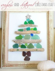 super cute Christmas craft idea with small pieces of seaglass and driftwood. Love the coastal feel of this!! so many great craft ideas at this link, thespacebetweenblog.net