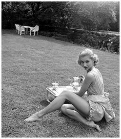 Vikki Dougan models sleepwear fashions, May 1952  Photo Nina Leen