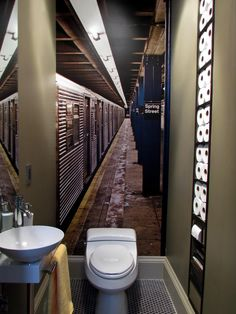 A transplanted New Yorker, now living in California, pays homage to New York City's subways with this tiny powder room. From Olive Juice Design, the homeowner wanted space to store toilet tissue. The recessed shelf offers plenty of storage from floor to ceiling.