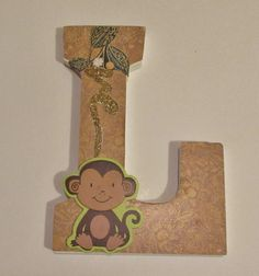"""Painted raw wood letter """"L"""" then applied scrap book paper over using Mod Podge. Leaves and stem are more pieces from scrap booking items. Monkey is pre-made/painted from craft store. Was for my grandson whose nickname is MonkeyBu**"""