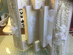 Tattered lace concertina card die with Tonic inner
