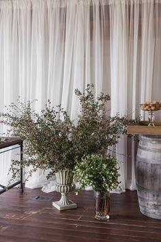 Rustic elegance - love these arrangements by the dessert table.   Photographer: Michele M. Waite